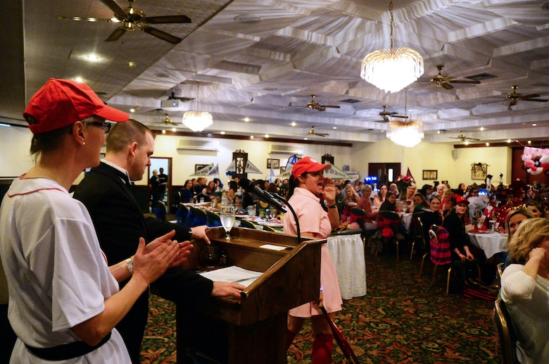 Diana Stuart, spouse of Col. Brian Stuart, 48th Maintenance Group commander, calls for her team during the Liberty Spouses Dining-In at Royal Air Force Lakenheath, England, May 8, 2015. More than 160 Liberty Wing spouses participated in the movie-themed event, which consisited of Liberty Oscar competitions in spirit, skits, costumes and table decorating table decorating. (U.S. Air Force photo by Senior Airman Erin O'Shea/Released)