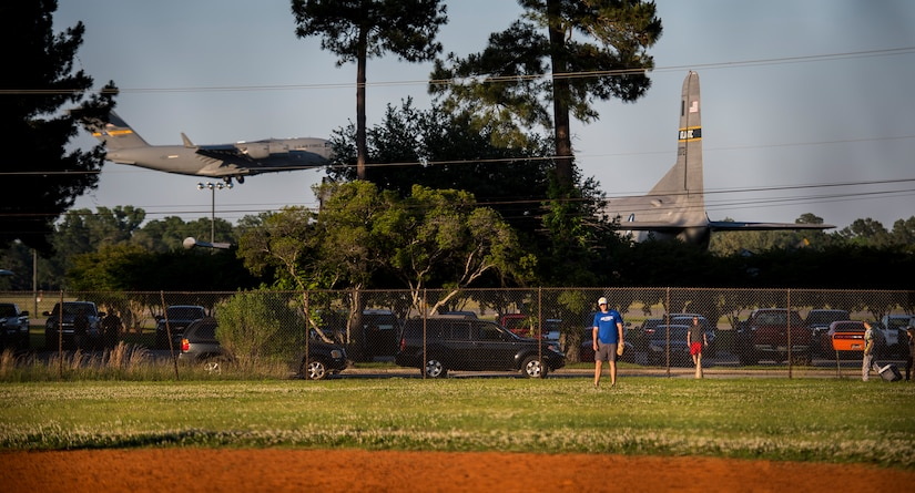 A C-17 Globemaster III prepares to land in the background during an Intramural Softball game, May 13, 2015 at Joint Base Charleston – Air Base, S.C. Joint Base Charleston's 2015 Intramural Softball Season is expected to run till mid-June. (U.S. Air Force photo/Airman 1st Class Clayton Cupit)