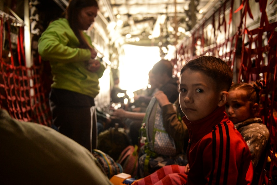 Military dependents wait for takeoff inside an Alaska Air National Guard C-130 Hercules at Osan Air Base, Korea, May 15, 2015. The dependents participated in a noncombatant evacuation exercise from Osan to Yokota Air Base, Japan. (Airman 1st Class Elizabeth Baker/Released)