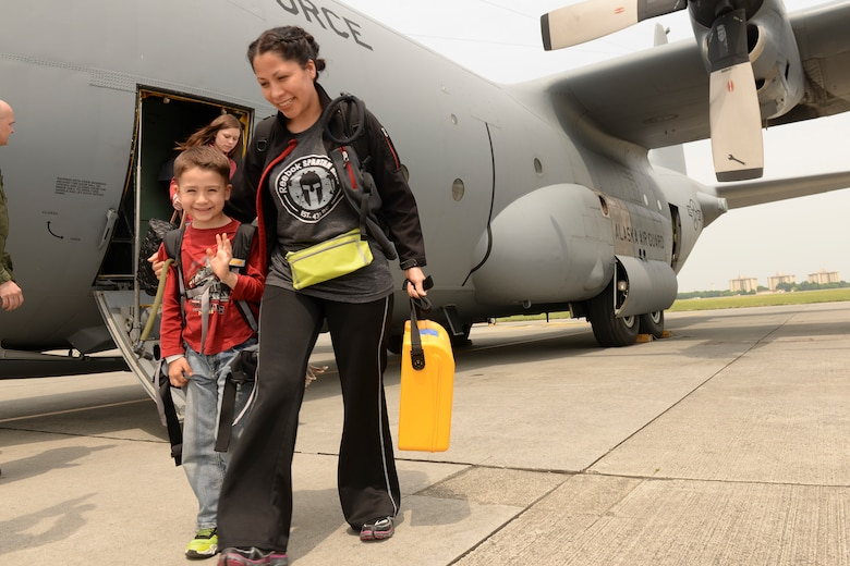 Military members and dependents living at Osan Air Base, Korea, arrive at Yokota Air Base, Japan, May 15, 2015. The dependents and military members went through the entire noncombatant evacuation process as part of a readiness inspection. (Airman 1st Class Elizabeth Baker/Released)