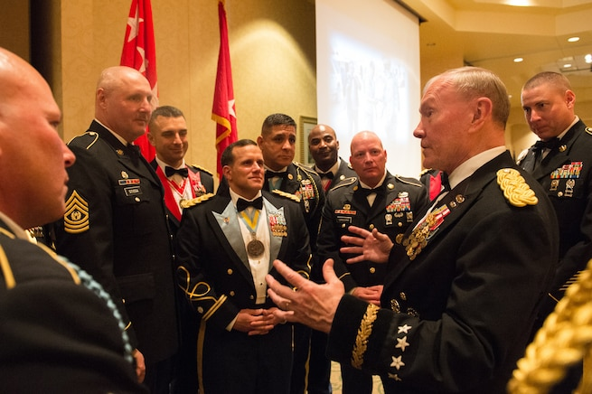 Army Gen. Martin E. Dempsey, chairman of the Joint Chiefs of Staff, talks with soldiers during the 2nd Armored Brigade Combat Team Ball in Junction City, Kan., May 15, 2015.