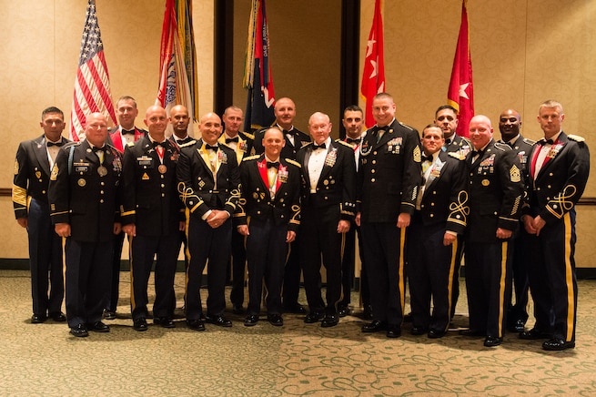 Army Gen. Martin E. Dempsey, chairman of the Joint Chiefs of Staff, poses for a photo with with senior members of the 2nd Armored Brigade Combat Team during their ball in Junction City, Kan., May 15, 2015.