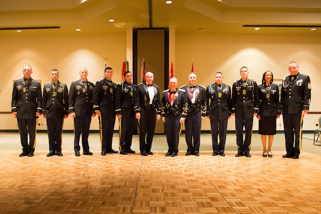 Army Gen. Martin E. Dempsey, chairman of the Joint Chiefs of Staff, poses for a photo with soldiers honored for outstanding leadership during the 2nd Armored Brigade Combat Team Ball in Junction City, Kan., May 15, 2015.