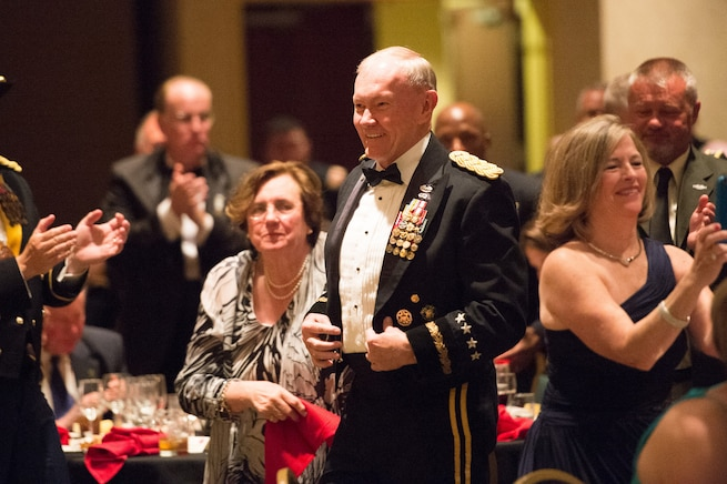 Army Gen. Martin E. Dempsey, chairman of the Joint Chiefs of Staff, smiles after being introduced by his son Army Maj. Chris Dempsey at the 2nd Armored Brigade Combat Team Ball in Junction City, Kan., May 15, 2015.