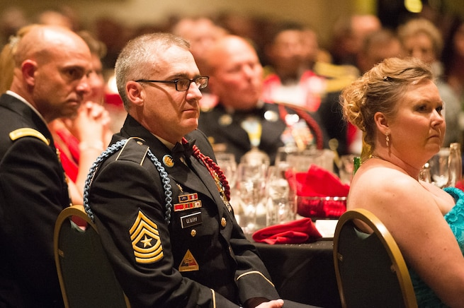 Army Sgt. Maj. Brian Gentry listens as Army Gen. Martin E. Dempsey, chairman of the Joint Chiefs of Staff, gives remarks at the 2nd Armored Brigade Combat Team Ball in Junction City, Kan., May 15, 2015.