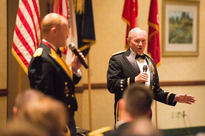 Army Gen. Martin E. Dempsey, right, chairman of the Joint Chiefs of Staff, and his son Army Maj. Chis Dempsey sing an Irish song during the 2nd Armored Brigade Combat Team Ball in Junction City, Kan., May 15, 2015.