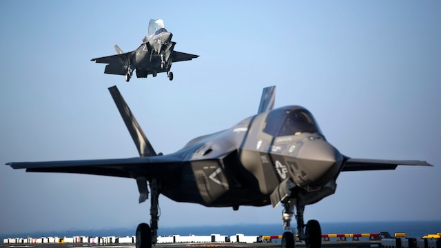 Two F-35B Lightning II Joint Strike Fighters complete vertical landings aboard the USS Wasp (LHD-1) during the opening day of the first session of operational testing, May 18, 2015. As the future of Marine Corps aviation, the F-35B will eventually replace all aircraft from three legacy Marine Corps platforms; th AV-8B Harrier, the F/A-18 Hornet, and the EA-6B Prowler. The aircraft are stationed with Marine Fighter Attack Training Squadron 501, Marine Aircraft Group 31, 2nd Marine Aircraft Wing, Beaufort, South Carolina and Marine Fighter Attack Squadron 121, Marine Aircraft Group 13, 3rd Marine Aircraft Wing, Yuma, Arizona. (U.S. Marine Corps photo by Lance Cpl. Remington Hall/Released)