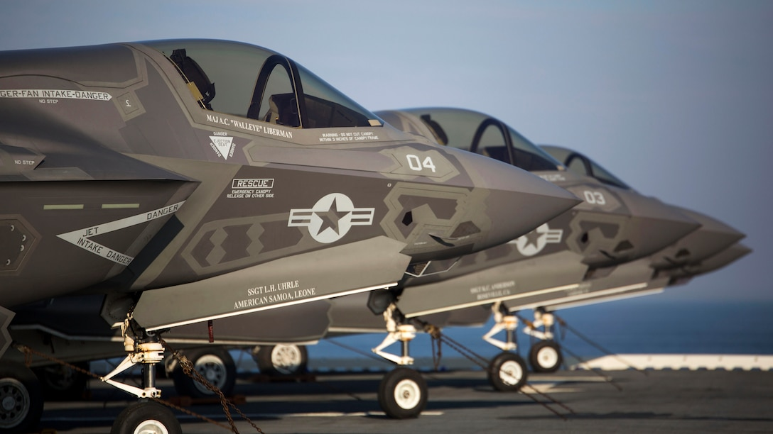 Four F-35B Lighting II Joing Strike Fighters sit secured to the deck after their arrival aboard the Uss Wasp (LHD-1), May 18, 2015. As the future of Marine Corps aviation, the F-35B will eventually replace all aircraft from three legacy Marine Corps platforms; th AV-8B Harrier, the F/A-18 Hornet, and the EA-6B Prowler. The aircraft are stationed with Marine Fighter Attack Training Squadron 501, Marine Aircraft Group 31, 2nd Marine Aircraft Wing, Beaufort, South Carolina and Marine Fighter Attack Squadron 121, Marine Aircraft Group 13, 3rd Marine Aircraft Wing, Yuma, Arizona. (U.S. Marine Corps photo by Lance Cpl. Remington Hall/Released)