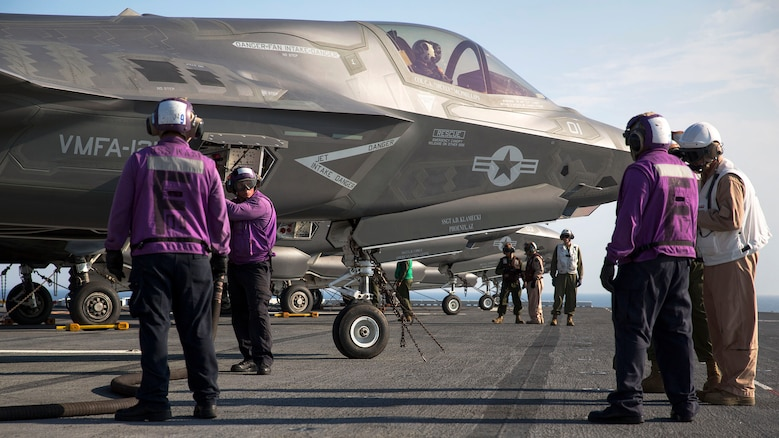 Marines and sailors aboard the Uss Wasp (LHD-1) secure and refuel an F-35B Lightning II Joint Strike Fighter after its arrival for the first session of operational testing, May 18, 2015. Data and information gathered from OT-1 will lay the groundwork for F-35B deployments aboard Navy amphibious ships and the announcement of the Marine Corps' initial operating capacity of the F-35B in July. The aircraft are stationed with Marine Fighter Attack Training Squadron 501, Marine Aircraft Group 31, 2nd Marine Aircraft Wing, Beaufort, South Carolina and Marine Fighter Attack Squadron 121, Marine Aircraft Group 13, 3rd Marine Aircraft Wing, Yuma, Arizona. (U.S. Marine Corps photo by Lance Cpl. Remington Hall/Released)
