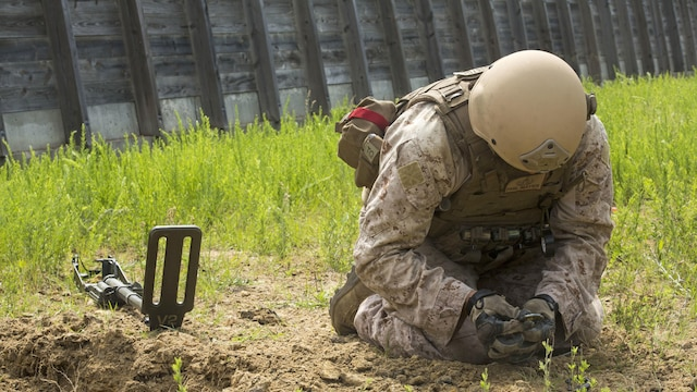 Staff Sgt. Philip Mayer, an explosive ordnance technician with 2nd Explosive Ordnance Company, 8th Engineer Support Battalion clears remnants of an improvised explosive device during a demolition exercise aboard Marine Corps Base Camp Lejeune, North Carolina, May 14, 2015. The exercise is part of the unit's preparations for an upcoming deployment with Special Purpose Marine Air-Ground Task Force Crisis Response-Africa and gave Marines hands-on training with tools that allow them to neutralize hazards while causing minimal damage in urban settings.