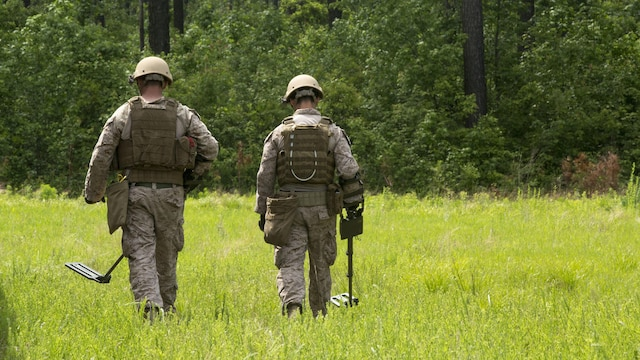 Explosive ordnance technicians with 2nd Explosive Ordnance Company, 8th Engineer Support Battalion patrol a field for improvised explosive devices using a compact metal detector during a demolition exercise aboard Marine Corps Base Camp Lejeune, North Carolina, May 14, 2015. The exercise is part of the unit's preparations for an upcoming deployment with Special Purpose Marine Air-Ground Task Force Crisis Response-Africa and gave Marines hands-on training with tools that allow them to neutralize hazards while causing minimal damage in urban settings.