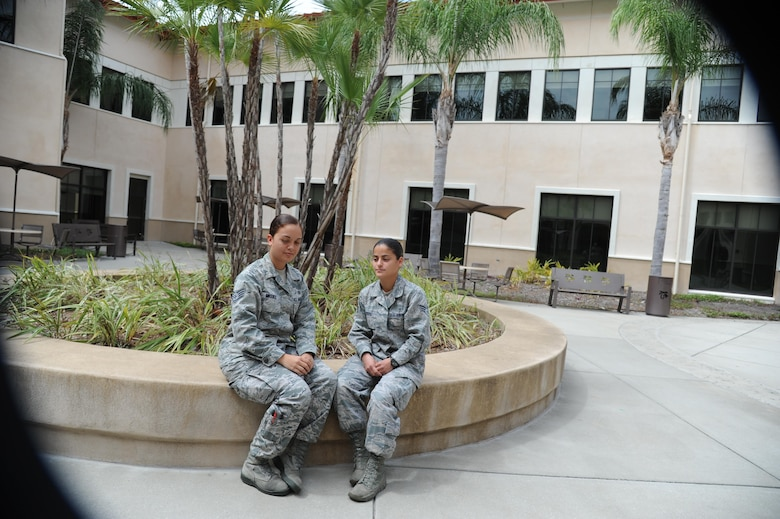 Staff Sgt. Naara Miguez Vera (left) and Senior Airman Lorimar Rivera, 927th Aerospace Medicine Squadron, MacDill Air Force Base Fla., plan to travel to Crystal City, Virginia, during the Memorial Day weekend to participate in the Tragedy Assistance Program for Survivors. TAPS, a not-for- profit organization that offers compassionate care to families grieving from the loss of loved ones serving in the U.S. Military. (U.S. Air force photo/ Senior Airman Xavier Lockley)