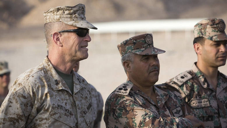 U.S. Marine Corps Maj. Gen. Burke Whitman and Jordanian Armed Forces Brig. Gen. Khaled Al Sharah, exercise commanders, Coalition Forces Land and Maritime Component Command, watch a Non-Commissioned Officer close order drill presentation, on Camp Titin, Jordan, during Exercise Eager Lion, May 14, 2015.  Eager Lion is a recurring, multinational exercise designed to strengthen military-to-military relationships, increase interoperability between partner nations, and enhance regional security and stability.