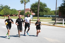 Team WFT - Black Shirts participates in the Centennial 100k Relay Race aboard Marine Corps Recruit Depot Parris Island, S.C., May 16, 2015. The WFT - Black Shirts finished the race in nine hours and two minutes. (Photo by Lance Cpl. Allison Lotz)