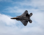 An F-22 Raptor demonstrates its maneuverability during the Wings Over the Pacific air show Sept. 28, 2014, at Joint Base Pearl Harbor-Hickam, Hawaii. The Raptor's sophisticated aero design, advanced flight controls, thrust vectoring, and high thrust-to-weight ratio provide the capability to outmaneuver all current and projected aircraft. (U.S. Air Force photo/Capt. Raymond Geoffroy)