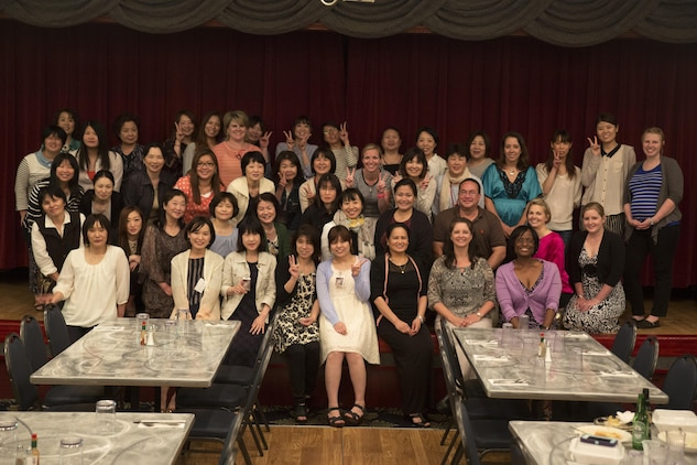 Nurses from Robert M. Casey Medical and Dental Clinic, Iwakuni Clinical Care, JA Hiroshima General Hospital and Medical Hospital Iwakuni Byoin pose for a picture during a Nurse's Week dinner social at the Club Iwakuni Ballroom aboard MCAS Iwakuni, Japan, May 11, 2015. Branch Health Clinic celebrated Nurse's Week for the first time, May 6-13, aboard station. Throughout the week, nurses from BHC came together for a series of events to celebrate a week that recognizes the importance and hard work that they do.