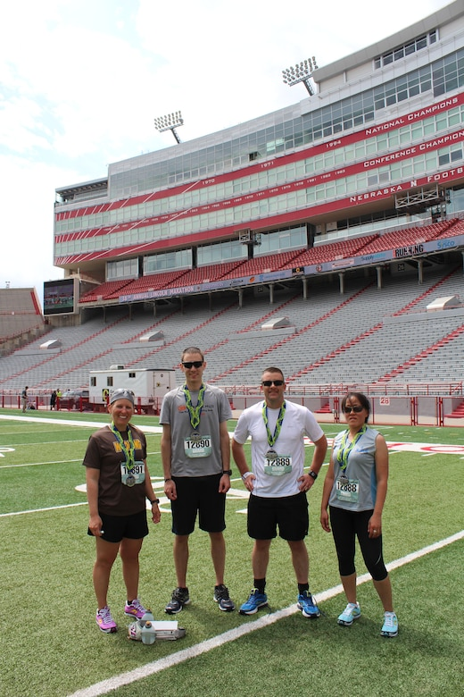 Wyoming National Guard Airmen and Soldiers assigned to the 153rd Airlift Wing and 960th Brigade Support Battalion pose on the University of Nebraska Memorial Stadium field after completing the Lincoln National Guard Marathon, May 3, 2015 in Lincoln, Nebraska. (courstesy photo)