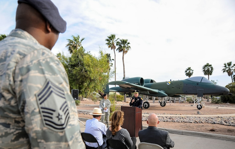 Service members and civilians listen as Tucson Police Capt. Michael Gillooly speaks about challenges and sacrifices law enforcement officials encounter, during a retreat ceremony for National Police Week at Davis-Monthan Air Force Base, Ariz., May 14, 2015. The ceremony honored security forces and other law enforcement members who have died in the line of duty. (U.S. Air Force photo by Staff Sgt. Angela Ruiz/released)