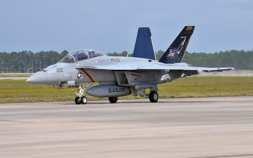 A U.S. Navy FA-18E Supert Hornet, from VFA-213 Fighting Black Lions based at Naval Air Station Oceana, Virginia, taxis on the runway at Tyndall Air Force Base, Fla. on May 14, 2015 during Combat Archer, the Air Force's air-to-air Weapon System Evaluation Program.