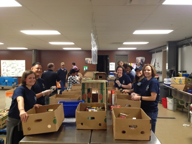 AFOSI's Region 8 personnel volunteered, May 15, 2015, at a food bank in Colorado Springs, Colo., as part of the U.S. Postal Service Care and Share food drive. Region 8 members sorted food that was recently collected.