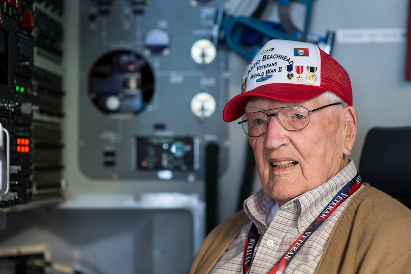 Kenneth Muston, an Anzio Beachhead Invasion veteran poses for a photo in the loadmaster seat on a C-17 Globemaster III, May 15, 2015 at Joint Base Charleston, S.C. during a tour of the installation. More than 20 veterans from the event were in Charleston to celebrate what could be their last reunion event together and to share their stories with the servicemembers stationed here. Muston, who is 91-years-old was a private first class from B Company 3rd Infantry Division. The invasion of Anzio, near the outskirts of Rome, began Jan. 22, 1944, lasted four months and took the lives of nearly 2,800 Americans. (U.S. Air Force photo/Senior Airman Jared Trimarchi)