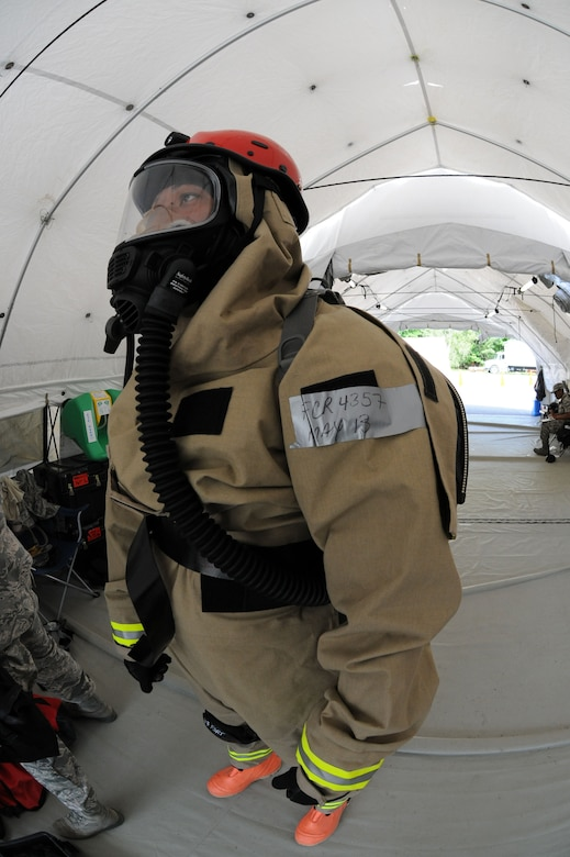 Tech. Sgt. Chito Reyes, 113th services flight, D.C. Air National Guard, suits up during Chemical Biological Radiological Nuclear (CBRN) Emergency Response Force Package training, May 14, 2015 in Virginia Beach, Va. Reyes is part of the 113th wing Fatality Search and Recovery Team.  (U.S. Air National Guard photo by Airman 1st Class Anthony Small)