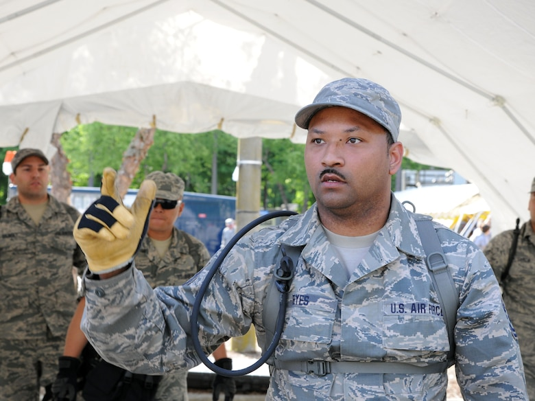 Tech. Sgt. Chito Reyes, 113th services flight, D.C. Air National Guard, briefs Bravo Team members during  Chemical Biological Radiological Nuclear (CBRN) Emergency Response Force Package training, May 14, 2015 in Virginia Beach, Va.  (U.S. Air National Guard photo by Airman 1st Class Anthony Small)