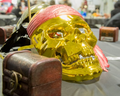 A skull mask lays on display as part of a table decoration for the Peace Carvin V Celebration at Mountain Home Air Force Base, Idaho, May 15, 2015. The ceremony is held every year in celebration of growing bond between the United States Air Force and the Singaporean Air Force. (U.S. Air Force photo by 2nd LT. Kippun D. Sumner/RELEASED)