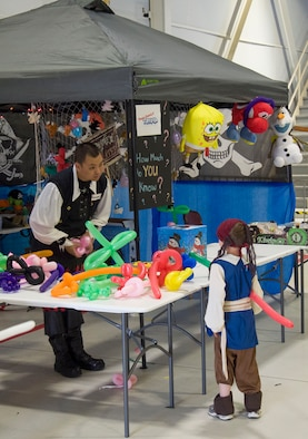 A member of the 428th Fighter Squadron takes a request for a balloon animal at the Peace Carvin V celebration at Mountain Home Air Force Base, Idaho, May 15, 2015. The celebration had numerous booths and games for children of the Gunfighter community. (U.S. Air Force photo by 2nd LT. Kippun D. Sumner/RELEASED)