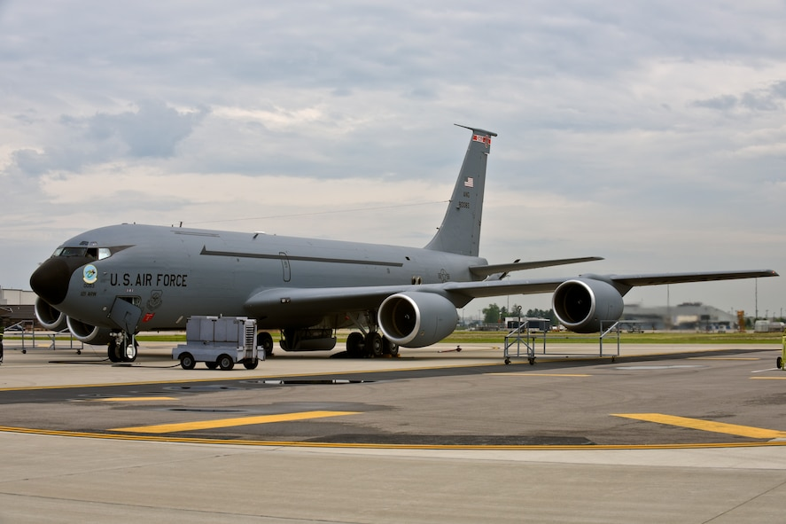 """A KC-135 Stratotanker at the 121st Air Refueling Wing, Rickenbacker Air National Guard Base, Ohio, receives new artwork, to include a block """"O"""" on the tail flash, racing stripes down the sides, """"eyebrow"""" painting over the pilot and co-pilot's windows, and nose art. Over the course of their normal maintenance schedule, the rest of the 121 ARW aircraft will receive the new artwork as well. (U.S. Air National Guard photo by Senior Airman Wendy Kuhn/Released)"""