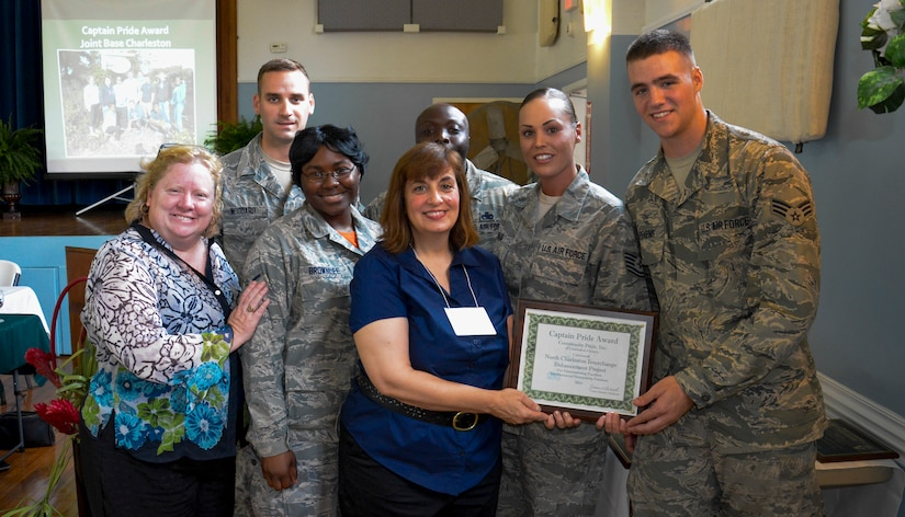 Airmen from the Joint Base Charleston chapter of the Keeping North Charleston Beautiful program were awarded the Captain Pride Award at the Felix C. Davis Community Center, North Charleston, S.C., May 15, 2015. Their work on the Community Butterfly Garden was recognized by the Charleston County Community Pride Organization. (Pictured left to right; Hon. Colleen Condon - Charleston City Council member, Senior Airman Zachary Woodard - 628th CPTS, Airman Shabria Brownlee – 628th CS, Vonie Gilreath – Pride Chairman, Master Sergeant Anthonio Dais – 437th MXS, Technical Sergeant Erica Dais – 628 CES, and Senior Airman Charles Stevens – 437th APS.) (U.S. Air Force Photo / Senior Airman Michael Reeves)