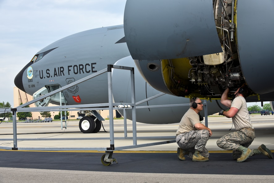 "A KC-135 Stratotanker at the 121st Air Refueling Wing, Rickenbacker Air National Guard Base, Ohio, receives new artwork, to include a block ""O"" on the tail flash, racing stripes down the sides, ""eyebrow"" painting over the pilot and co-pilot's windows, and nose art. Over the course of their normal maintenance schedule, the rest of the 121 ARW aircraft will receive the new artwork as well. (U.S. Air National Guard photo by Senior Airman Wendy Kuhn/Released)"