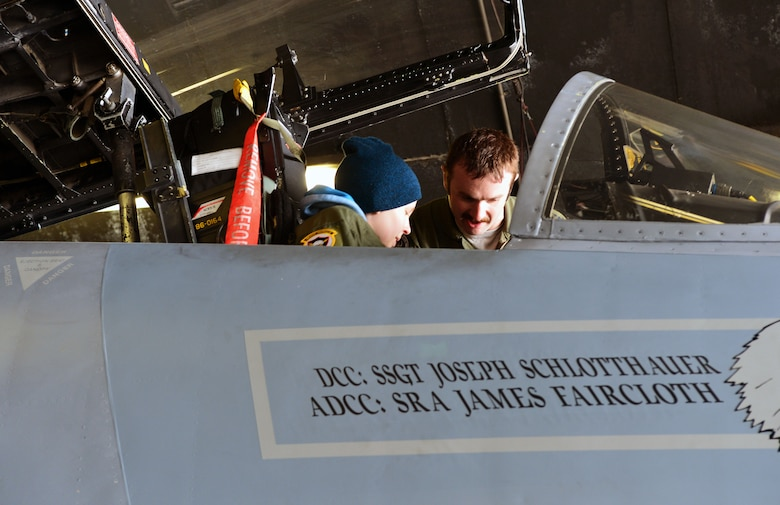 U.S. Air Force Captain Jason Ford, 871st Air Expeditionary Squadron F-15C Eagle fighter aircraft pilot, shows Gunnar Guðlaugsson the cockpit of an F-15C Eagle fighter aircraft during the Pilot for a Day program at Keflavik International Airport, Iceland, May 13, 2015.The final part of the program included a tour of one of the F-15Cs stationed at Keflavik for Icelandic Air Surveillance and Policing. (U.S. Air Force photo by 2nd Lt. Meredith Mulvihill/Released)