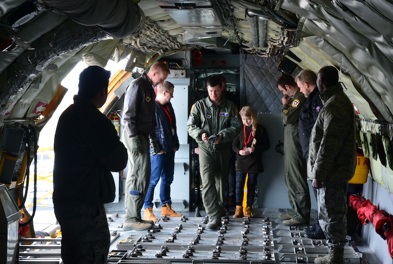 U.S. Airmen from the 871st Air Expeditionary Squadron give Gunnar Guðlaugsson, Arna Tryggvadóttir and their families a tour of a KC-135 Stratotanker aircraft during the Pilot for a Day program at Keflavik International Airport, Iceland, May 13, 2015. The program allowed two terminally ill Icelandic children to tour operations at Keflavik and experience a day in the life of a U.S. Air Force pilot.(U.S. Air Force photo by 2nd Lt. Meredith Mulvihill/Released)