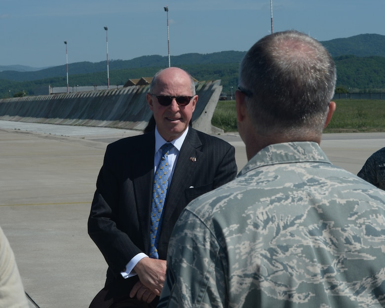 Theodore Sedgwick, U.S. Ambassador to Slovakia, speaks to a U.S. Air Force Airman assigned to the 354th Expeditionary Fighter Squadron during a theater security package deployment at Sliac Air Base, Slovakia, May 18, 2015. The U.S. values the shared commitment and close cooperation with NATO partners on the security and stability of Europe. (U.S. Air Force photo by Senior Airman Dylan Nuckolls/Released)