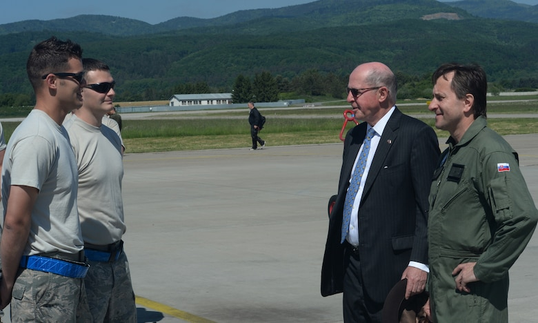 U.S. Air Force Airmen assigned to the 354th Expeditionary Fighter Squadron speak to Theodore Sedgwick, U.S. Ambassador to Slovakia, center right, and Slovakian air force Brig. Gen. Miroslav Korba, Slovakian air force commander, right, during a theater security package deployment at Sliac Air Base, Slovakia, May 18, 2015. As part of the deployment, the U.S. and Slovakian air forces will train together May 18-22 to improve interoperability in allied air operations and multinational close-air-support operations. (U.S. Air Force photo by Senior Airman Dylan Nuckolls/Released)
