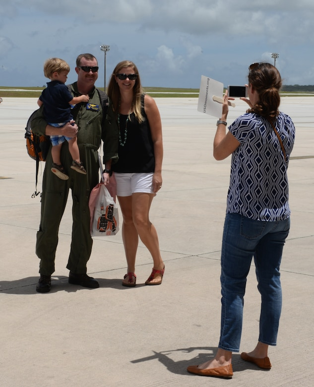 Lt. Cmdr. Brian Musfeldt, Helicopter Sea Combat Squadron 25 operations officer, smiles for a photo with his family after a five month deployment May 11, 2015, at Andersen Air Force Base, Guam. While deployed, the members of HSC-25 successfully integrated three MH-60S helicopters with the Air Combat Element during amphibious integration training and certification exercise and Korea Marine Exchange Program. (U.S. Air Force photo by Senior Airman Amanda Morris/Released)