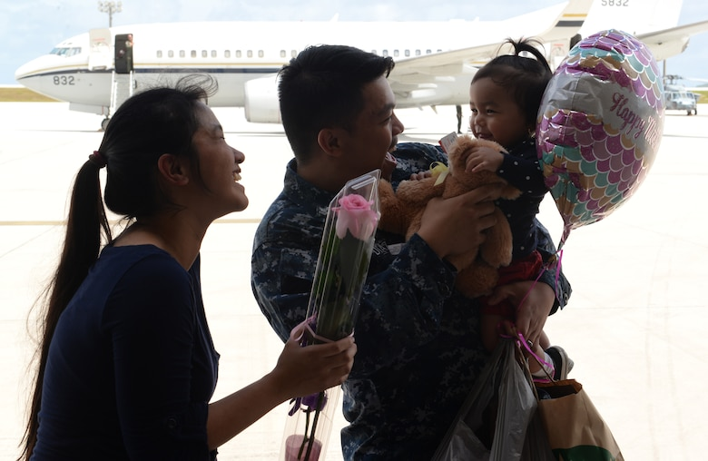 Aviation Electronics Technician Petty Officer 2nd Class Nico-Vincent Diaz, Helicopter Sea Combat Squadron 25, greets his family after a five month deployment May 11, 2015, at Andersen Air Force Base, Guam. HSC-25 worked closely with the 31st Marine Expeditionary Unit while fostering interoperability between the Navy and Marine Corps. (U.S. Air Force photo by Senior Airman Amanda Morris/Released)