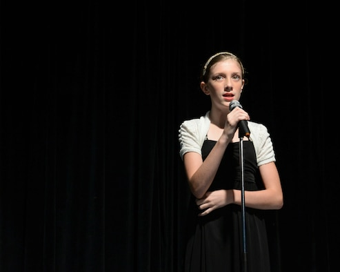 Haylee, contestant, sings during an audition for Operation Talent Search May 7, 2015, at Andersen Air Force Base, Guam. The Operation Talent Search Air Force level overall winner will compete online with the winners from two other talent competitions, Mission Audition and #Vocal Upload, to become the Air Force Entertainer of the Year. (U.S. Air Force photo by Senior Airman Amanda Morris/Released)