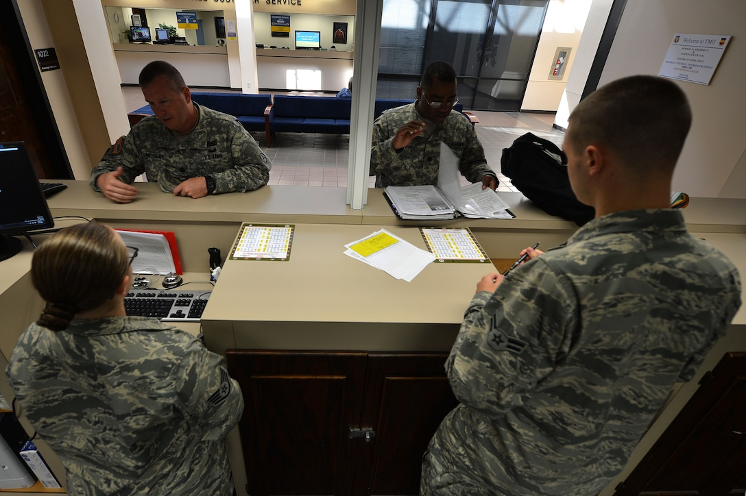 U.S. Air Force Airmen assigned to the 20th Logistics Readiness Squadron traffic management office, assist Team Shaw members with in-processing and out-processing at Shaw Air Force Base, S.C., May 19, 2015. Summer is the peak of permanent change of station season in which the TMO office could service approximately 3,500 outgoing and incoming Team Shaw members. (U.S. Air Force photo by Airman 1st Class Michael Cossaboom/Released)
