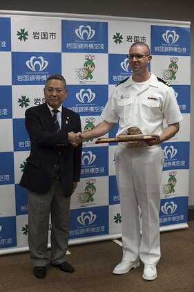 "Navy Lt. Nathan Hemerly, a family medicine doctor at the Robert M. Casey Medical and Dental Clinic, and Akehiko Date, chairmen at the General Incorporated Association Iwakuni City Sports Association, pose for a picture after Date presented Hemerly with a certificate of appreciation at the City Hall in Iwakuni City, Japan, May 12, 2015. After participating in the 9th annual Kintaikyo Road Race in Iwakuni City, Hemerly performed CPR, with the help of a local Japanese nurse, on another run participant who fell and became unconscious during the race. ""I was just doing what I thought was the right thing to do, I wasn't looking for any attention,"" said Hemerly."