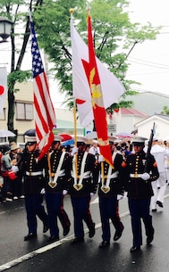 The Marines of the CATC Camp Fuji Color Guard proudly bear the National Flags of the U.S. and Japan, as well as the Marine Corps Standard, at the Shimoda Black Ships Festival.