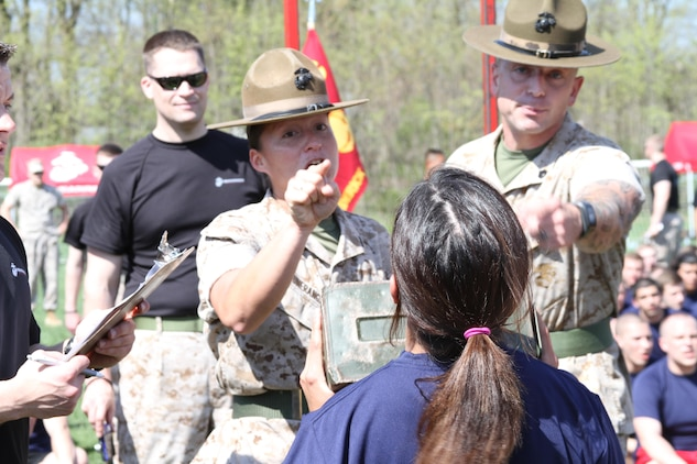 U. S. Marine Corps Staff Sergeants Angela L. Arounerangsy, left, a native of Honolulu, Hawaii, and Benjamin T. Estep from Ashley, Ohio, encourage a future Marine as she performs ammo-can lifts during Recruiting Station Frederick's 2015 Annual Pool Function April 18, 2015 at Frederick Community College in Frederick, Maryland. Both Arounerangsy and Estep are drill instructors at Marine Corps Recruit Depot Parris Island, South Carolina. (U.S. Marine Corps photo by Sgt. Anthony J. Kirby/Released)