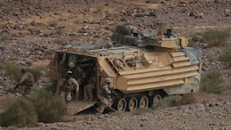 Italian Marines exit an Amphibious Assault Vehicle from Kilo Company, Battalion Landing Team 3rd Battalion, 6th Marine Regiment, 24th Marine Expeditionary Unit, during bilateral platoon attack drills as part of Exercise Eager Lion 2015 in Jordan, May 11, 2015. Eager Lion is a recurring multinational exercise designed to strengthen military-to-military relationships, between partner nations and enhance regional security and stability. The 24th MEU is embarked on the ships of the Iwo Jima Amphibious Ready Group and deployed to maintain regional security in the U.S. 5th Fleet area of operations.