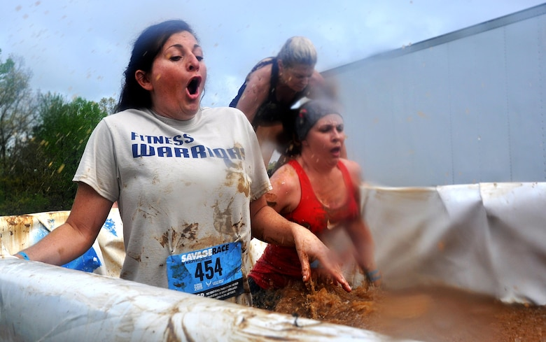 Tech. Sgt. Vicki Brown, 94th Airlift Wing Command Post, wades through a muddy pool of ice water during the Georgia Spring 2015 Savage Race in Dallas, Ga., April 18, 2015. The Savage Race is an Air Force Reserve sponsored obstacle course that challenges participants in more than 20 different trials over the course of five miles. (U.S. Air Force photo/Senior Airman Daniel Phelps)