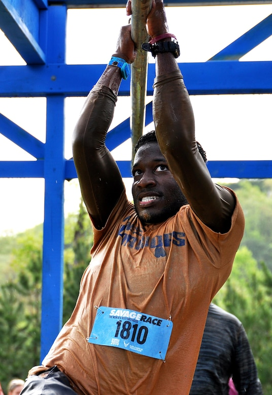 Jordan Jones, son of Senior Master Sgt. Eric Jones, 94th Logistics Readiness Squadron, shimmies across bars over a pool of water during the Georgia Spring 2015 Savage Race in Dallas, Ga., April 18, 2015. The Savage Race is an Air Force Reserve sponsored obstacle course that challenges participants in more than 20 different trials over the course of five miles. (U.S. Air Force photo/Senior Airman Daniel Phelps)