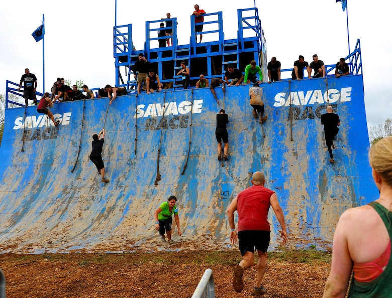 Savage Race participants climb the Colossus during the Georgia Spring 2015 Savage Race in Dallas, Ga., April 18, 2015. The Colossus was a giant 43-foot wall and one of the hardest obstacles in the course. Adding to the difficulty of it being one of the final obstacles, runners had to sprint up the barrier after they'd already sledged through more than four miles in the mud, before grabbing a rope. They would then pull themselves up to the top of the fortification. The Savage Race is an Air Force Reserve sponsored obstacle course that challenges participants in more than 20 different trials over the course of five miles. (U.S. Air Force photo/Senior Airman Daniel Phelps)