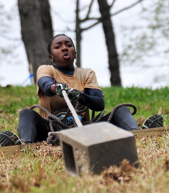 Erica Jones, daughter of Senior Master Sgt. Eric Jones, 94th Logistics Readiness Squadron, pulls a masonry brick up a hill during the Georgia Spring 2015 Savage Race in Dallas, Ga., April 18, 2015. The Savage Race is an Air Force Reserve sponsored obstacle course that challenges participants in more than 20 different trials over the course of five miles. (U.S. Air Force photo/Senior Airman Daniel Phelps)