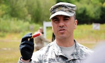 "Maj. Jason V. Sama, Joint Non-Lethal Weapons Directorate, instructs U.S. Naval War College students on the non-lethal 12 gauge fin-stabilized round at Camp Fogarty Training Center, Rhode Island National Guard on May 13, 2015. The students participated in Range Day, which is part of the JPME's elective course, ""Non-Lethal Weapons: Supporting the Operational Art Across the Range of Military Operations."""
