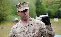 "Maj. Peter B. Young, Joint Non-Lethal Weapons Directorate, instructs U.S. Naval War College students on the 40mm foam baton round at Camp Fogarty Training Center, Rhode Island National Guard on May 13, 2015. The students participated in Range Day, which is part of the JPME's elective course, ""Non-Lethal Weapons: Supporting the Operational Art Across the Range of Military Operations."""